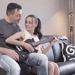Image Tanara invatata sa cante la chitara si fututa de barbat matur